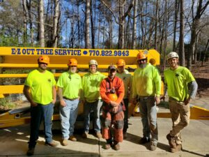 Tree service employees together for group picture